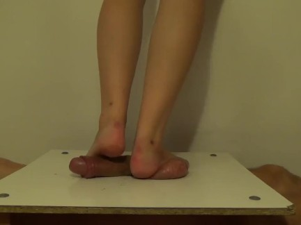 Barefeet cockcrushing, standing full weigh on cock-balls, stomping on cock