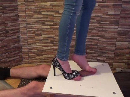 High heels and footjob in jeans
