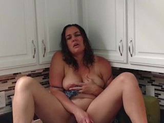 Busty Mom plays with toy then fucks herself on kitchen counter
