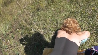 Pervert masturbate on sunbathing naked woman on wild beach and cumshot POV