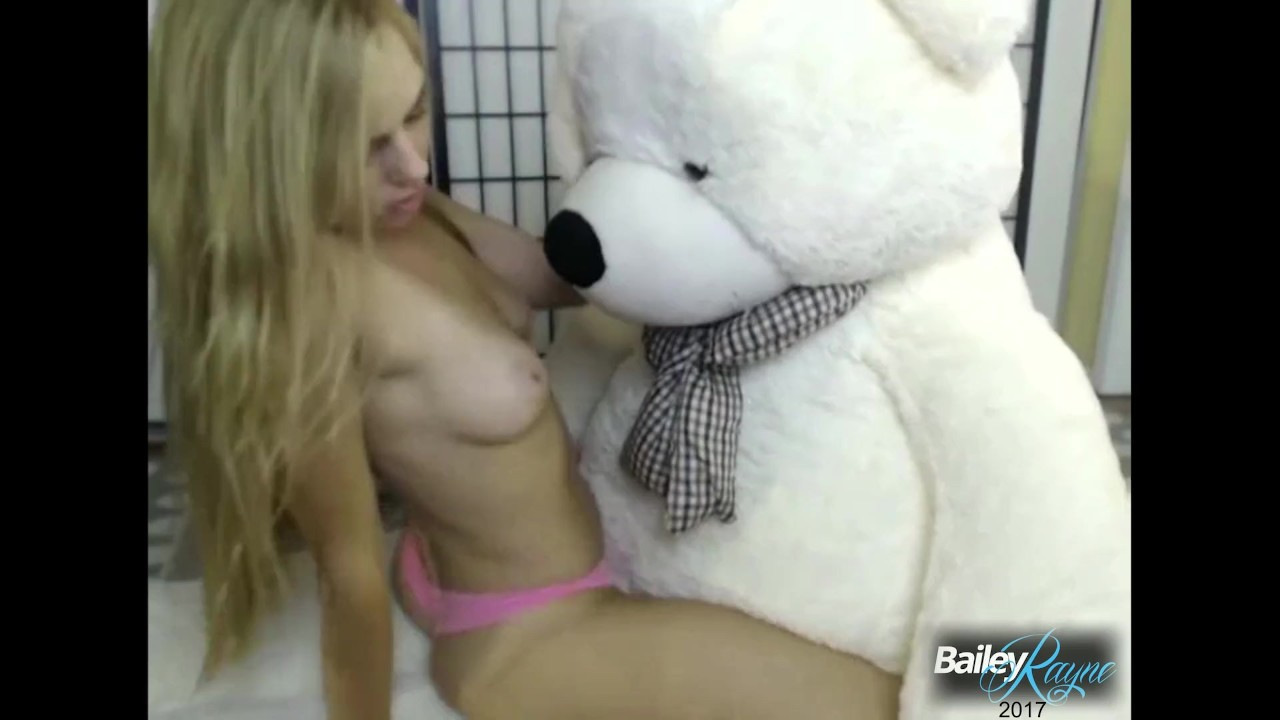 Cute teen rides teddy bear