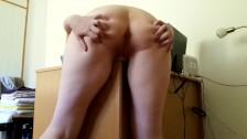 Little Redhead rubs against a desk and cums hard