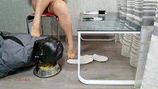 Slave eats from the floor and mistress feet.