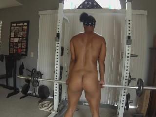 ebony milf yoga instructor lifts weights nude