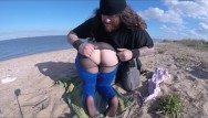 Clothing swinger Gymnast girl is groped and has her clothes tear on beach