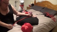 Helpless bondage struggle Man hogtied and gagged by woman on bed and struggling to get free