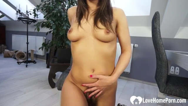 hot busty brunette shows her very hairy pussy
