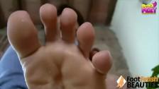 Sexy teen taking off socks showing her cute feet