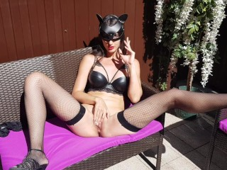 Catwoman masturbates outdoors
