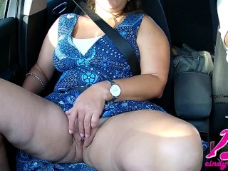 While he drives I play with my shaved pussy