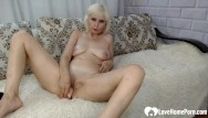Shoved it into the girls pussy Blonde shoves a huge dildo into her slit