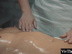 Sexy lesbian oils up lover before licking her wet pussy