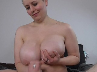 Bayesia jerks a cock until it cums on her tits.