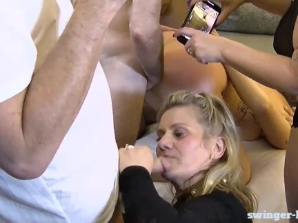 Amateur swingers sucking cock and fucking in homemade swinger orgy