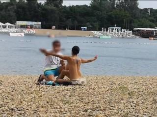Milf Lilly naked on public beach got oil massage from stranger