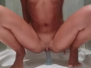 HOT BRUNETTE TEEN RIDES A DILDO AND SQUIRTS IN THE SHOWER